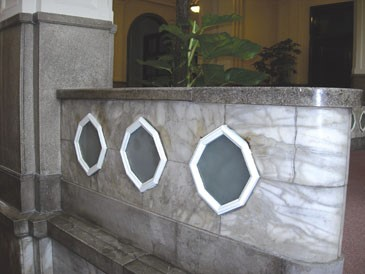 8.There are some specificoutstanding octagon shape lights on the short wall._2